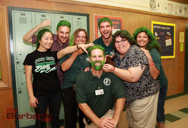 Muir Middle School staff and teachers go green after school raises more than $10,000 in 60 days to renovate their aging auditorium. (Photo by Ross A. Benson)