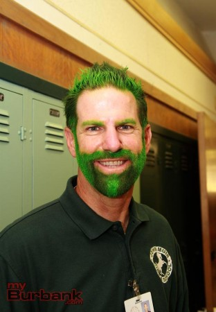 Muir Principal Dr. Greg Miller shows his school spirit with green hair after the school raised close to $13,000 in 60 days to renovate the aging auditorium. (Photo by Ross A. Benson)