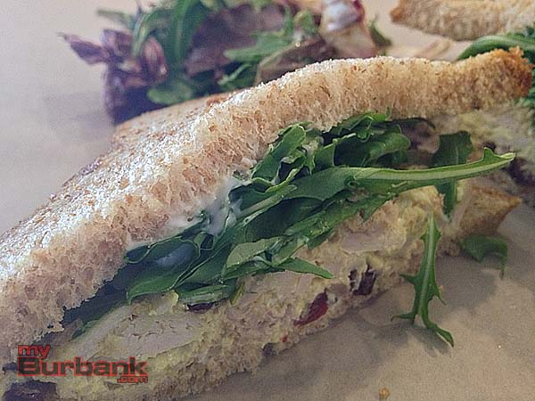 Cold chicken curry sandwich on rustic multi-grain bread is a mouthful of amazing tastes.  (Photo By Lisa Paredes)