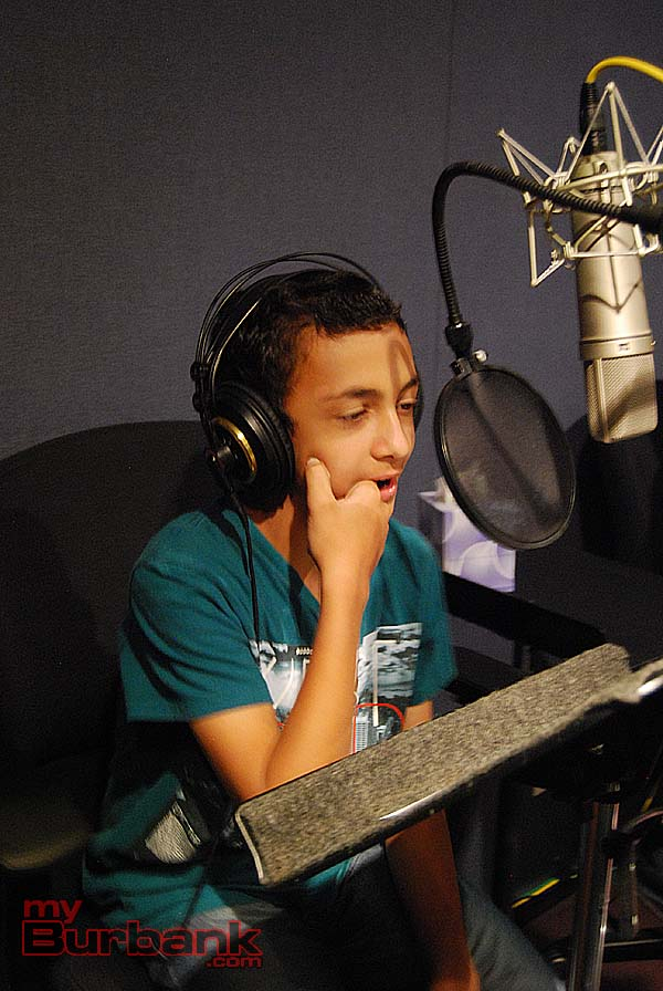 "A student makes a vocal effect as directed for ""Teenage Mutant Ninja Turtles."" (Photo By Lisa Paredes)"