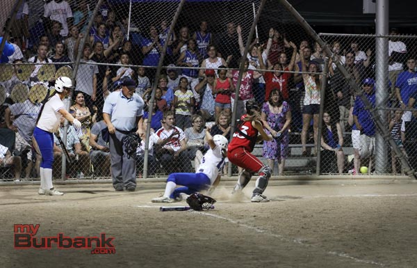 Bridgette Pisa slides across home plate safely with the winning run (Photo by Ross A. Benson)