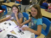 Sydney Bax and Kelly Matlock, fourth-graders at Roosevelt, learn about William Shakespeare the man. (Photo Courtesy of Colleen Matlock)