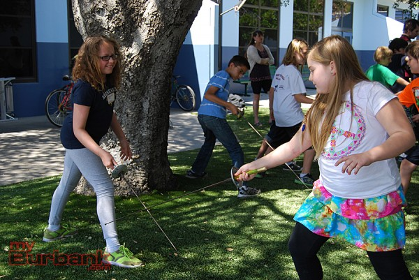 Penelope White and Nova McNally, Roosevelt fourth-graders, spar with foils.  (Photo By Lisa Paredes)