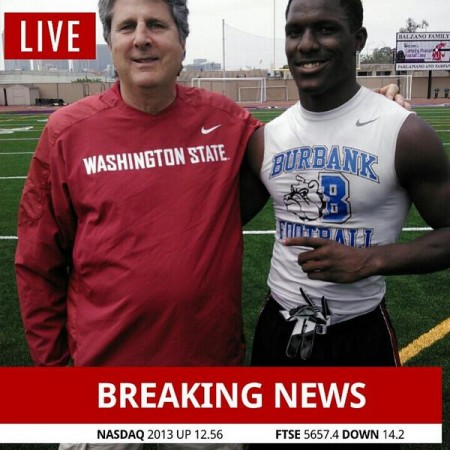 Washington State coach Mike Leach with James Williams last week
