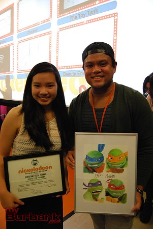 Kendra Sazon, grade 10, smiles with mentor Jeffry Mazon (Background Painter, TMNT.) (Photo By Lisa Paredes)