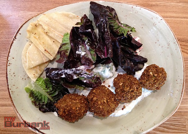 Falafel salad with red gem lettuces, tomato, cucumber, red onion, parsley and a yogurt dressing. (Photo By Lisa Paredes)