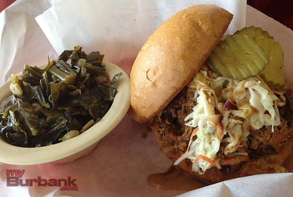 Sharkey's collard greens and pulled pork sandwich are out-of-this-world delicious. (Photo By Lisa Paredes)