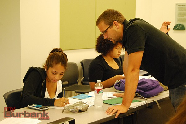 Burbank High School teacher Robert Hammell helps a student in Algebra 2. (Photo By Lisa Paredes)