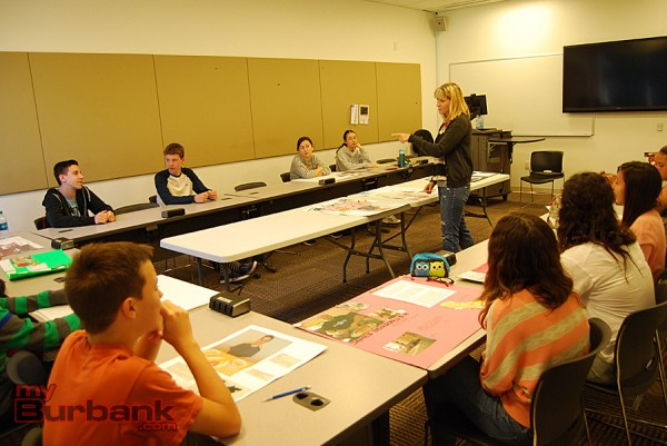 Burroughs High School Health teacher Oakley Gillett discusses student projects in Health class. (Photo By Lisa Paredes)