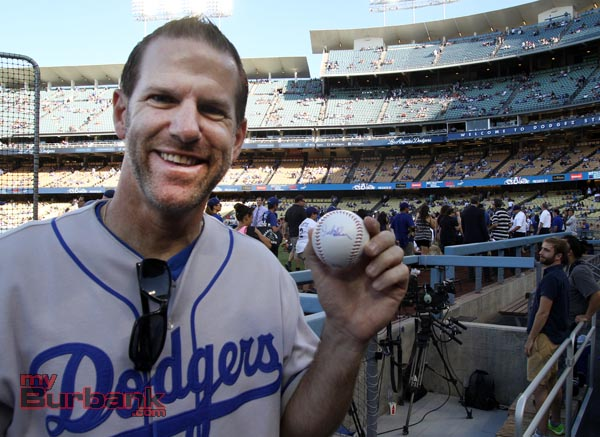 John Muir Principal Dr. Greg Miller proudly shows off his Orel Hershiser autographed baseball prior to the game (Photo by Ross A. Benson)