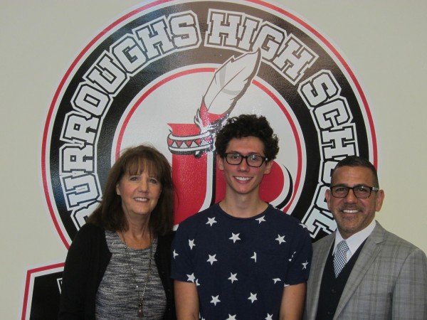 Burroughs High School counselor Sheila Masters and Principal John Paramo announce senior Brennan Flynn's (center) selection for National Merit Scholarship semifinalist. (Photo Courtesy John Burroughs High School)