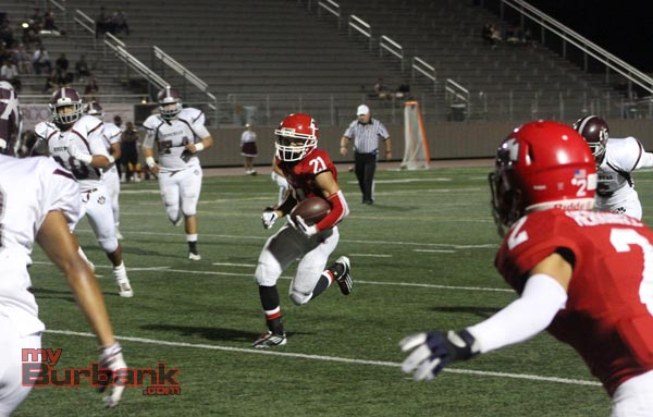 Aidan Anding breaks free on a punt return (Photo by Ross A. Benson)