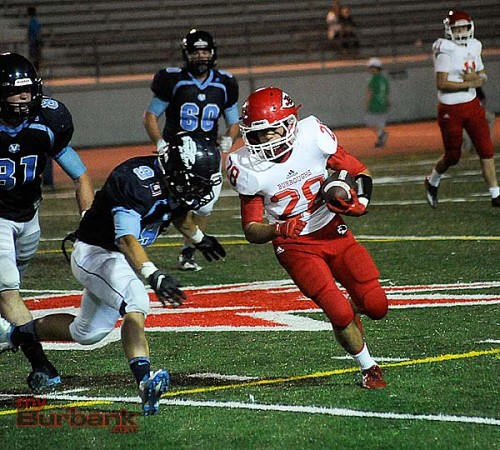 Michael Ospina of JBHS looks for running room (Photo by Craig Sherwood)