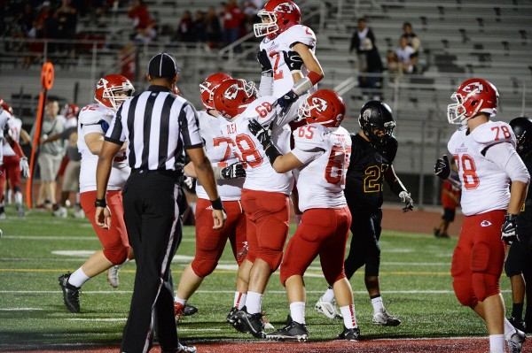 Burroughs was triumphant in a 33-21 win at Santa Fe (Photos courtesy of Mitch Haddad)