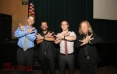 """Using sign language to say """"superhero"""" are (left to right) Principal Dr. Greg Miller, John Maucere, Daniel Swartz and Paul Raci. (Photo by Ross A. Benson)"""