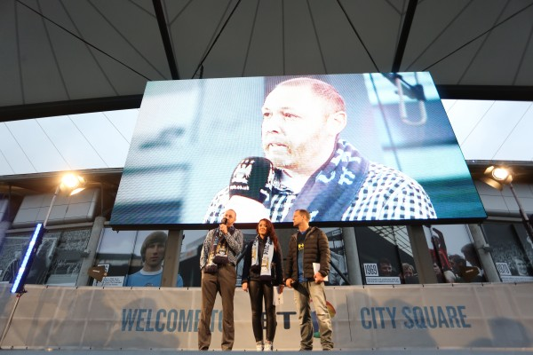 Ian MacLeod shares his story with fans on stage at BT City Square, as Natalie Pike and Danny Johnson, two of the Club's match day and special events presenters, look on. (Photo Courtesy of Manchester City Football Club)
