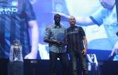 Manchester City Football Club's Yaya Toure receives Player of the Year award from Burbank resident Ian MacLeod on stage at City Live in Manchester, England. (Photo Courtesy of Manchester City Football Club)