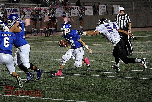 Sophomore QB Guy Gibbs evades pressure (Photo by Craig Sherwood)