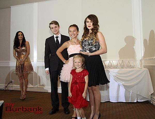 Pictured is Bella King along with her sister Sage Tousey, and Lead Actress Caitlin Carmichael award presenter Tanner Cusumano (Photo by Ross A. Benson)