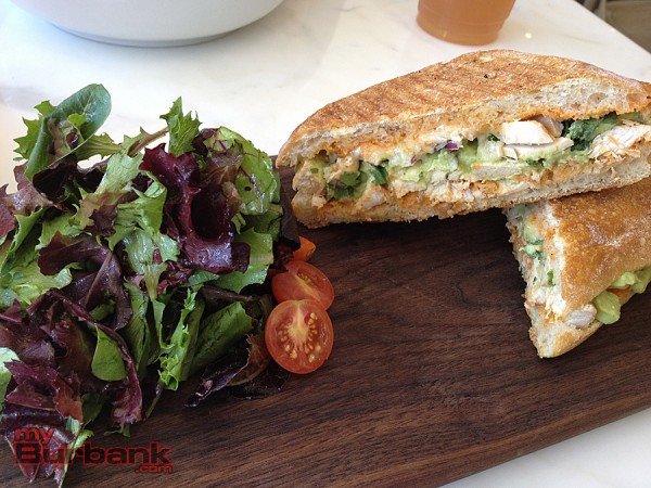 Olive & Thyme's Spicy Chicken sandwich has a nice kick and is paired with a light baby green salad. (Photo By Lisa Paredes)