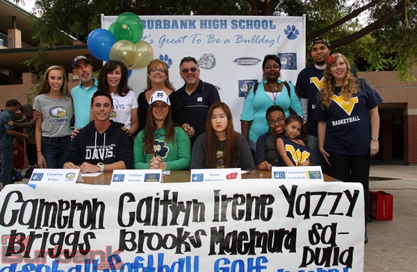 Family members join the quartet of Bulldog signees (Photo by Ross A. Benson)