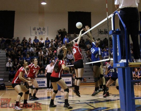 Burbank's Rose Cowart and Burroughs' battle for the ball (Photo by Ross A. Benson)