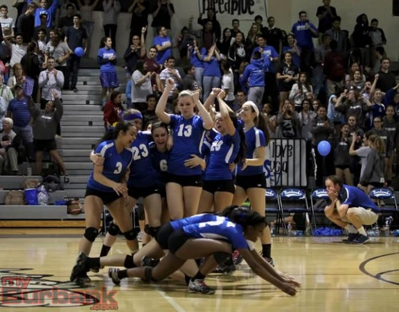 Burbank begins its celebration while Coach Kyle Roach gathers himself (Photo by Ross A. Benson)