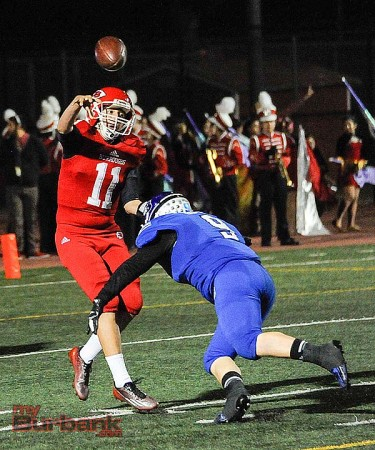The Bulldogs defense pressured Burroughs QB Andy Amela throughout the game (Photo by Craig Sherwood)