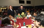 Captain Craig Summerfield along with his wife Marianneke serve some guests during this years Thanksgiving Dinner. (Photo by Ross A. Benson)