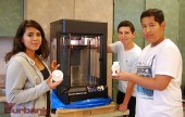 Burbank High School art students (from left to right), eleventh-grader Lizbeth Najera, tenth-grader Storm Lamoureaux and twelvth-grader Mark Gonzalez, show some of the pieces created with the school's 3D printer. (Photo By Lisa Paredes)