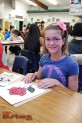 Kiara Teixeira, a seventh-grader at Muir, enjoyed the Japanese paper cutting art class. (Photo By Lisa Paredes)