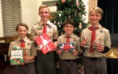 Four of the Boy Scouts from Troop 209 wrapping holiday gifts are, from left, Ethan Lucsik, Christopher Coomber, Dylan Gilberto and Hayden Lucsik. ( Photo courtesy John Dlugolecki)