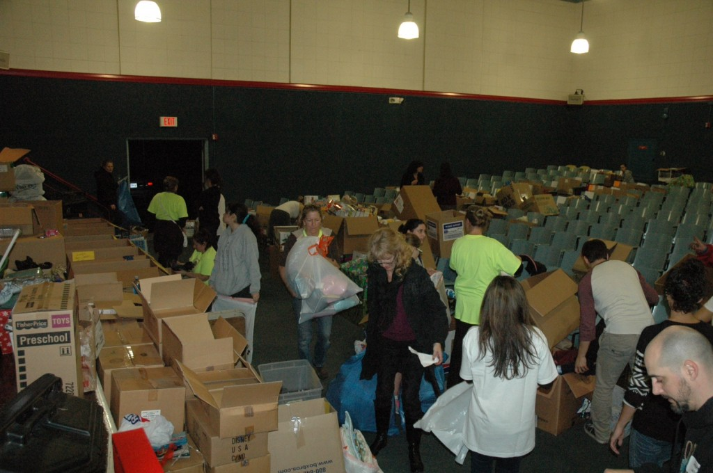 Like Santa's elves, volunteers scurry to fill baskets of food, gifts and toys at Washington Elementary School  (Photo by Joyce Rudolph)