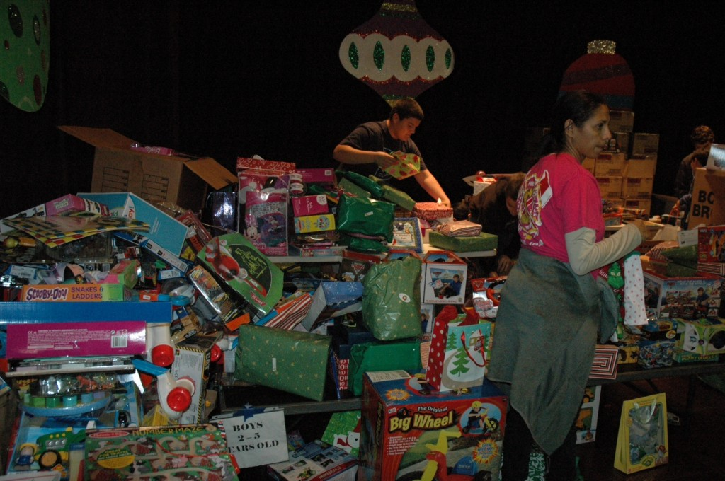 Volunteers organize the toys during the Burbank Coordinating Council's Holiday Basket program on Friday at Washington Elementary School  (Photo by Joyce Rudolph)