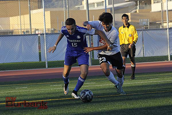 Burroughs' VJ Salazar fights for the ball (Photo By Edward Tovmassian)