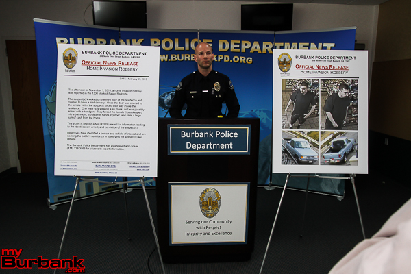Burbank Police Officer Josh Kendrick the Police Departments P.I.O. pictured with information related to residential home invasion robbery.( Photo by Ross A. Benson)