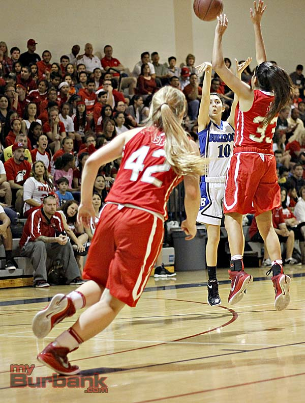 Ani Temurian of Burbank  attempts a shot against Burroughs Abbey Ibarra (Photo By Edward Tovmassian)