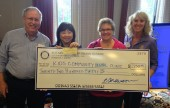 Dale Gorman from Kid's Dental Clinic receives aGrant Check from Burbank Sunrise Rotary