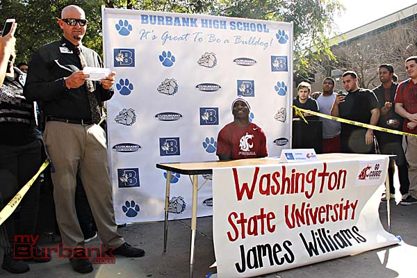Assistant Principal of Athletics Matt La Belle (lt) and Burbank High held a signing ceremony in honor of James (Photo By Edward Tovmassian)