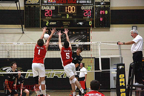 Bailey Carter (left) and Andrew Dalmada go for a block (Photo by Dick Dornan)