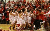 The Burroughs student body rushes the floor to celebrate with the Lady Indians on another monumental victory (Photo by Ross A. Benson)