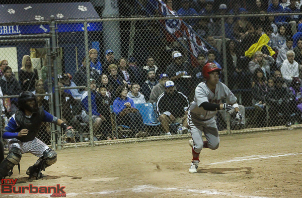 Anthony Bocanegra lays down a bunt to score a run in the Indians victory (Photo by Ross A. Benson)