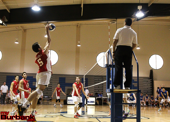 Burroughs' Andrew Dalmada goes up for a kill in the Indians' victory (Photo by Ross A. Benson)