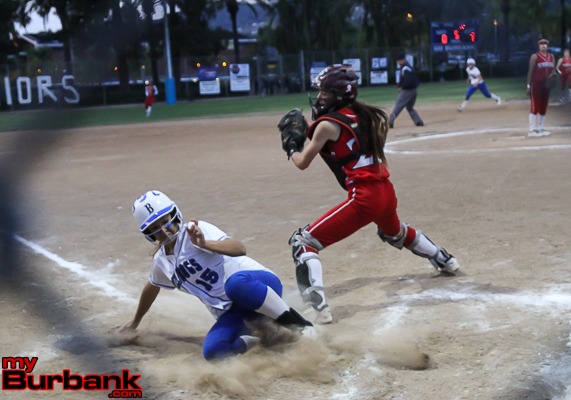Bridgette Pisa slides in safely for another Bulldogs run (Photo by Ross A. Benson)