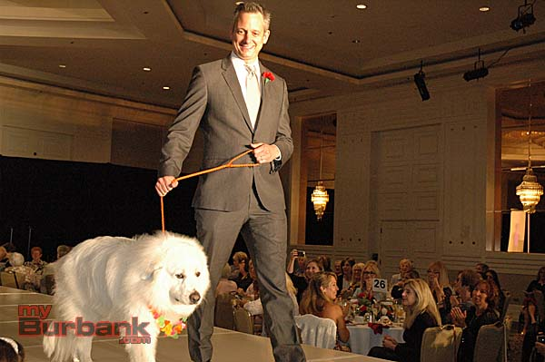 The surprise of the day was Nick Testa, chief medical officer of Providence St. Joseph Medical Center, escorting Romeo, a six-year-old Great Pyrenees owned by Ann Valladares, down the runway.