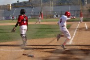 Ryan Galan crosses home plate for the Indians
