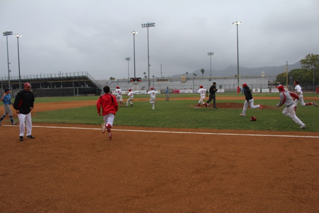 The Indians rush the field to greet Max DeAmicis (Photo courtesy of Ivan Galan)