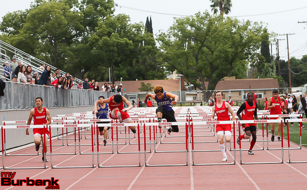 Burroughs Corwin Scherer takes 1st place in the 110 Meter Varsity Hurdles with Burbank High's Martn Swan in second as Burroughs Nathan Bradley took 3rd. (Photo by Ross A. Benson)