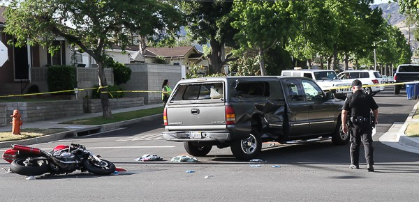 Burbank Police Traffic Officers Tim Dryness investigates this motorcycle vs pickup truck accident that occurred Wednesday afternoon at Griffith Park and Victory Blvd. The motorcycle rider was transported to LA County USC Medical Center with serious injuries. (Photo by Ross A. Benson)