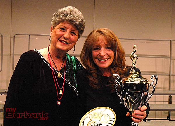 Verdugo Hills Showtime Chorus a cappella festival Chair Pat Kahmann, left, presents trophy to Christine DeMore, director of Jordan Middle School's Madrigals, on Saturday at Glendale High School.